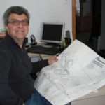 Jack Gentile from Pauls Landscaping sitting in his office reading plans