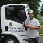 Marc Lafontaine owner of the tree service Émondage Lafontaine stands by his truck