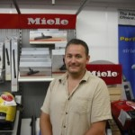Mike Smith owner of Vacu Pro appears here in his vacuum cleaner store