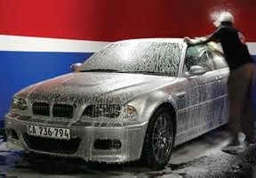 Employee washing a car in a lave-auto in Ville St.Laurent