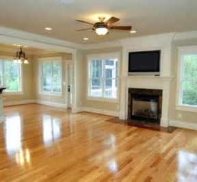 New flooring in a living room with a fireplace and large windows