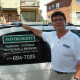 André Zylinski owns the painting business company called the Paintologists stands by his vehicle wearing a white t-shirt