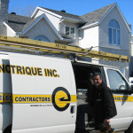 The electrician Domenic Iasenza on the job standing by his white truck