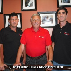 Owner of Spanish Ornamental staircases in a red t-shirt with his sons in black t-shirts standing up