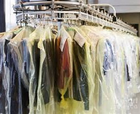 Clothes covered with plastic after being cleaned at the cleaner