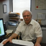 Micheal Kafenzakis - Mortgage Broker sitting at his desk