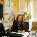 Adela Szulzinger sitting at her desk at the daycare Centre Éducatif La Sagesse