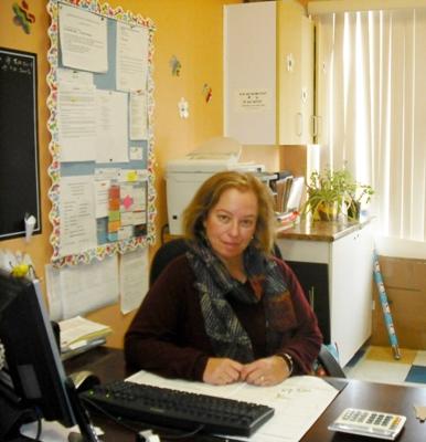 Adela Szulzinger sitting at her desk at the daycare Centre Éducatif La Sagesse