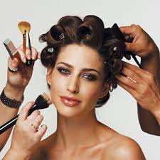 Model getting her hair and make up done
