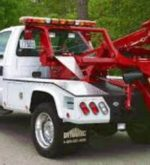 White and red towing truck